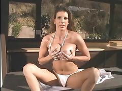 Hot brunette with big tits gets horny and rubs her tits and fingers her pussy