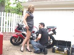Biker dude gets his dick sucked by a pair of hotties outdoors