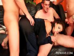 Slut taking three cocks gets pissed on