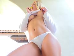 Sexy blonde girl in a white sweater fucks a banana