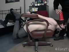 Curly-haired babe is tied up so that the guys can play with her pussy