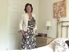 Alluring mature dame in stocking spreading legs in bed