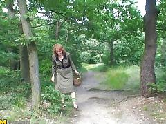 Fascinating matured granny giving big cock blowjob in the forest