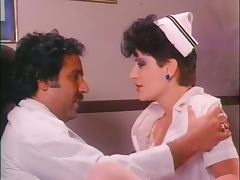 Retro Porn Legend Ron Jeremy Eats and Fingers a Horny Nurse's Hairy Pussy