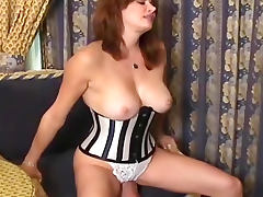 Tight corset on sexy facesitting woman