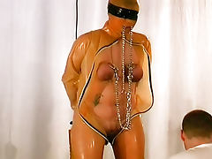 Shaved head girl in BDSM play