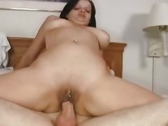 Black haired babe rides a hard cock