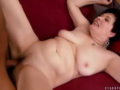 Dark haired granny Goldee enjoys sucking a dick before jumping on it