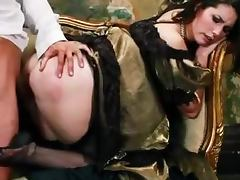 Horny brunette girl in vintage dress gets fucked on a sofa