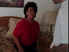 Older brunette rides a hard cock