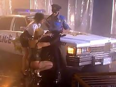 POlice officer is fucking two whores on the street