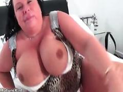 Nasty mature slut rubs her huge tits