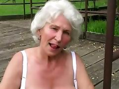 Horny Granny Rubs Her Cunt Outdoor Before Blowjob