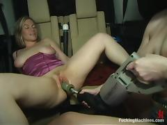 Dana Dearmond and Lindsey Grant play with a sex machine in a car
