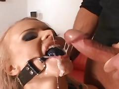 Curly blonde swallows two big cocks