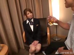 A Japanese stewardess rides a dick in a hotel room