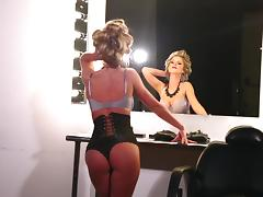 Kimber Cox wears a sexy corset in solo scene